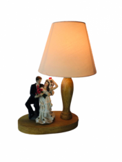 Wooden table lamp with shade and wedding statue